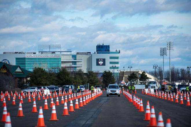 In the shadow of Rentschler Field in East Hartford a 10-lane COVID-19 vaccination clinic opened Monday, January 18 to vaccinate eligible individuals in Phase 1a and 1b by appointment only. It is Connecticut's largest drive-through clinic and is administered by Community Health Center, Inc.
