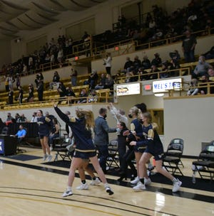 The St. Thomas Aquinas girls basketball team celebrates after defeating Andover Central for the Class 5A state championship Saturday at White Auditorium in Emporia.