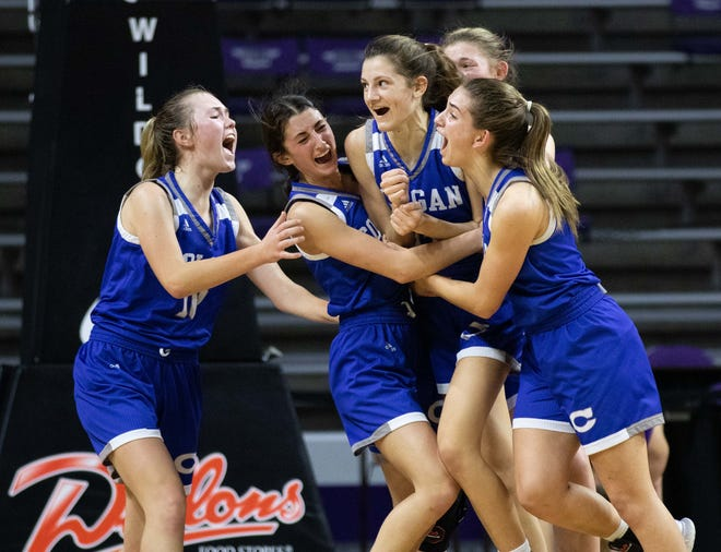 Colgan freshman Lilly Brown is mobbed by her teammates after hitting a buzzer beater to win the game against Valley Heights. Colgan defeated Valley Heights 40-38 in the Class 2A semifinal Friday, March 12, 2021.