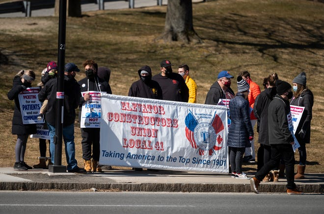 Members of the Elevator Constructors Union, Local 41 showed support for the striking St. Vincent Hospital nurses Saturday in Worcester.