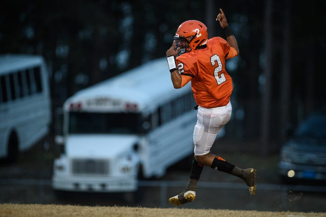 South View's Cedavion Wimbley celebrates after making a touchdown during the first quarter against E.E. Smith on Friday, March 12, 2021 at South View High School.