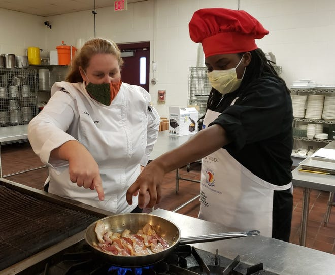 Eastside High School's  Institute of Culinary Arts magnet is an American Culinary Federation (ACF) certified program, one of only four high school culinary arts programs in the state of Florida. Chef Pam Bedford, who runs the program, is pictured with one of her students cooking in the ICA kitchen. [Submitted photo]