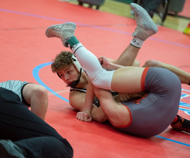 Newcomerstown's Logan Hursey pins Dalton's Greyson Siders at 138 pounds in the opening round of the Division III State Wrestling Tournament at Marion Harding