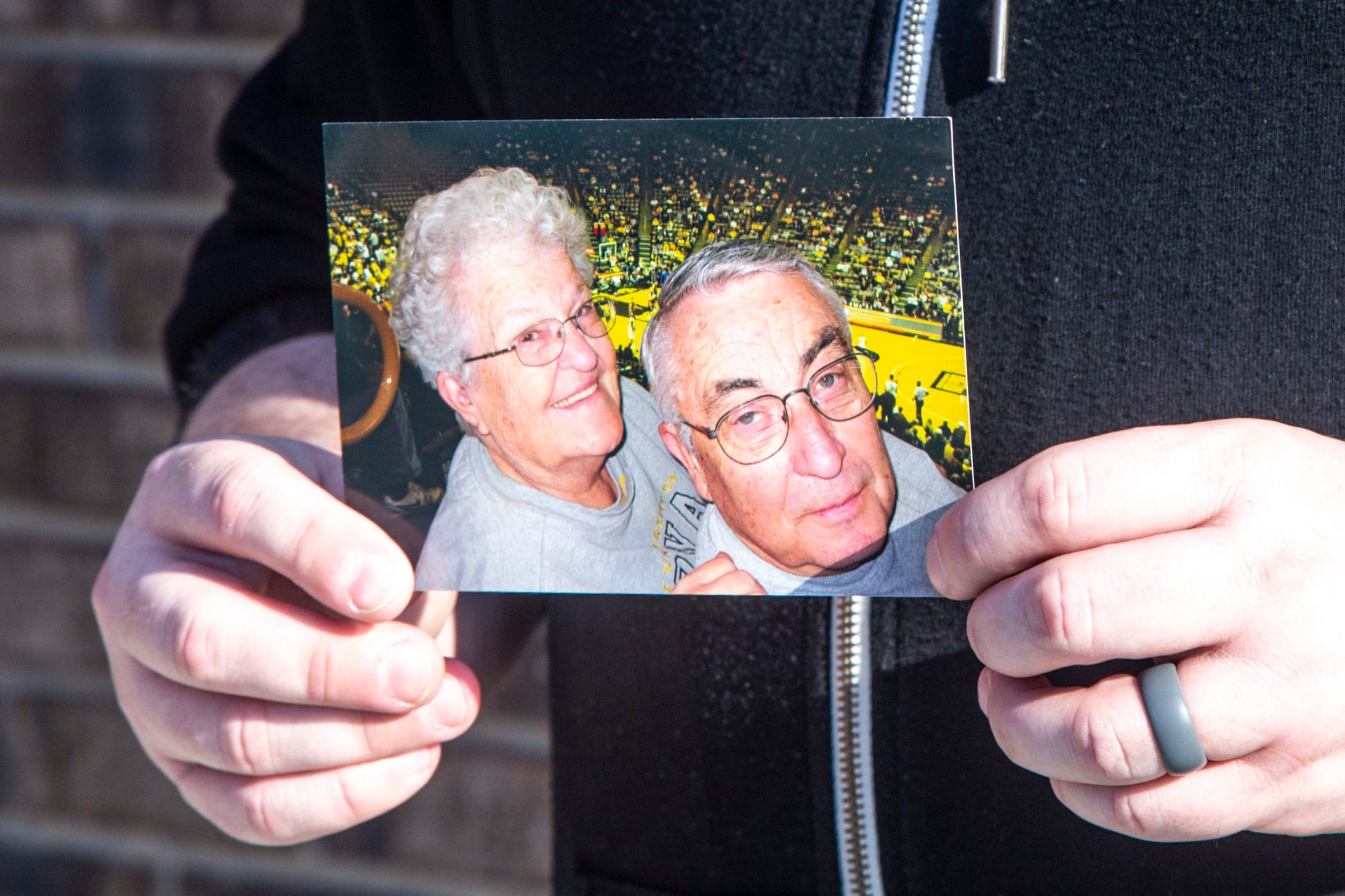 Adam Skibbe holds a photo of his grandparents Jane and Norry Gronert, Sunday, March 7, 2021, in Tiffin, Iowa. The two were attending a men's basketball game at Carver-Hawkeye Arena.