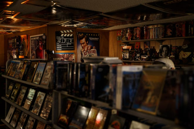 7,000 movies and accompanying promo materials line the walls and ceiling of Brian and Erin Hogan's basement on Thursday, March 11, 2021, in Urbandale, IA. A movie enthusiast since he was a kid, Brian started collecting the movies and got the shelves as video stores closed to store them. The homage to video stores materialized as their daughter moved out and the video store shelves moved in.