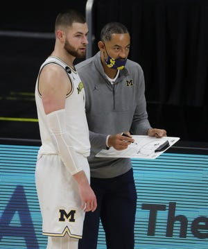 Michigan center Hunter Dickinson listens to head coach Juwan Howard against Ohio State during the Big Ten tournament Saturday, March 13, 2021 at Lucas Oil Stadium in Indianapolis.