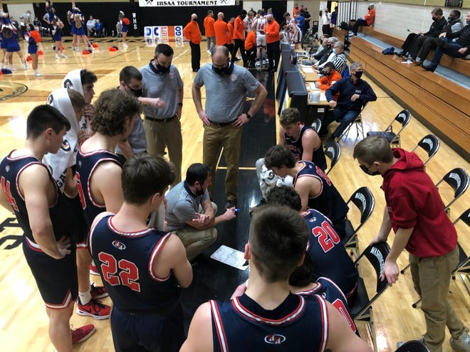 Heritage Hills coach Nate Hawkins talks to his players during a break in Saturday's regional game. The Patriots fell to No. 2 Silver Creek 42-48.