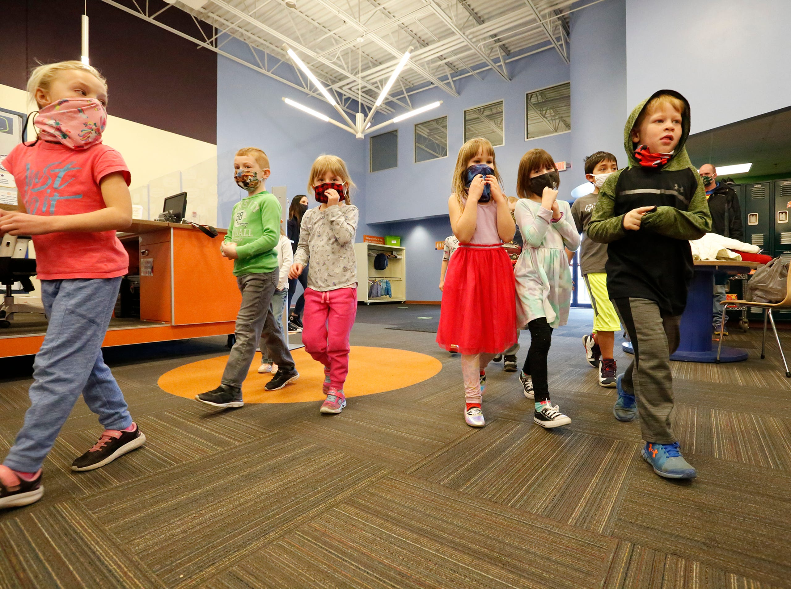 Kids enter to play Saturday, March 13, 2021 at the Fond du Lac Children's Museum in Fond du Lac, Wis. The museum opens today to the public after being closed because of the Covid-19 pandemic. Doug Raflik/USA TODAY NETWORK-Wisconsin