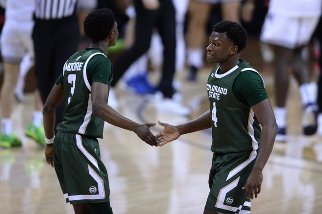 Colorado State Rams guards Isaiah Stevens (4) and Kendle Moore (3) celebrate during a timeout against the Utah State Aggies during the first half at Thomas & Mack Center in Las Vegas, Nevada on Friday, March 12, 2021.