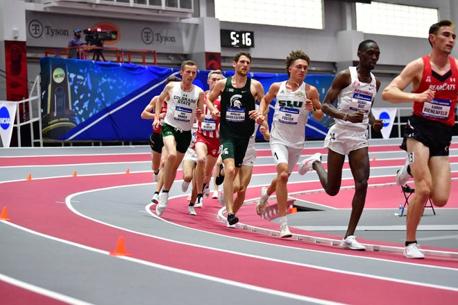 CSU's Eric Hamer, left, runs in the main pack early in the men's 5,000 meters Friday, March 12, 2021, at the NCAA Indoor Track and Field Championships. Hamer finished 2nd, breaking his own school record by over 7 seconds with a time of 13:29.96.