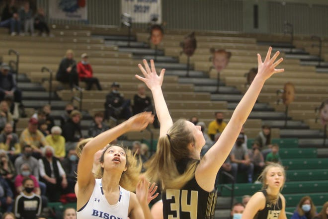 Great Falls High's Alison Harris, left, gets ready to battle for a rebound with Billings West's Sydney Pierce in Saturday's consolation semifinal game during the Class AA State Tournament at Four Seasons Arena.