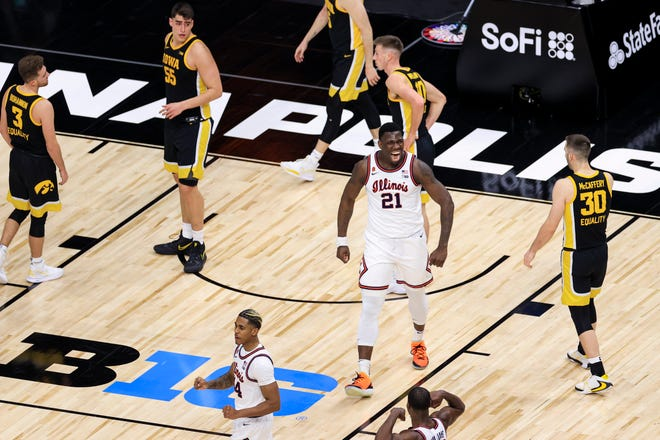 Mar 13, 2021; Indianapolis, Indiana, USA; Illinois Fighting Illini center Kofi Cockburn (21) reacts to making a basket while being fouled in the game against the Iowa Hawkeyes in the first half at Lucas Oil Stadium. Mandatory Credit: Aaron Doster-USA TODAY Sports