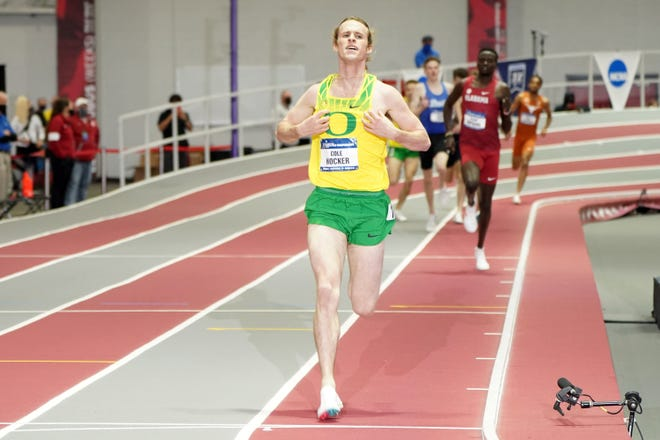 Cole Hocker of Oregon celebrates after winning the mile in a meet-record 3:53.71 during the NCAA Indoor Track and Field Championships at the Randal Tyson Center.