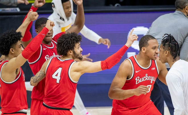 Ohio State Buckeyes players celebrate the win against Michigan Wolverines on Saturday, March 13, 2021, during the men's Big Ten basketball tournament from Lucas Oil Stadium. Ohio State Buckeyes beat Michigan Wolverines 68-67.