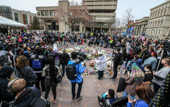 Protesters gathered in Jefferson Square Park on Saturday, March 13, 2021, on the anniversary of the murder of Breonne Taylor.