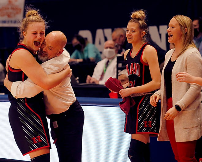 Hiland forward Zoe Miller hugs coach Dave Schlabach during a Division III state final at U.D. Arena in Dayton Mar. 13, 2021.