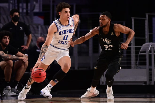 Memphis guard Lester Quinones drives the ball against a UCF defender during the AAC Tournament quarterfinals on Friday, March 12, 2021 in Fort Worth, Texas.