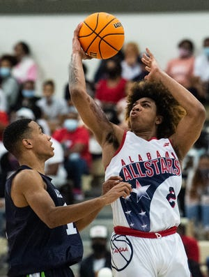 Alabama's JD Davison (Calhoun) (2) goes up for a layup during the Alabama-Mississippi boys basketball All-Star game at the Cramtown Bowl Multiplex in Montgomery, Ala., on Friday, March 12, 2021. Mississippi All-Stars defeated Alabama All-Stars 93-91.