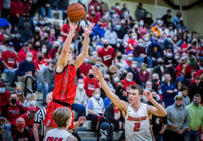 Blackford's Luke Brown shoots past Wapahani's defense during their regional game at Lapel High School Saturday, March 13, 2021.
