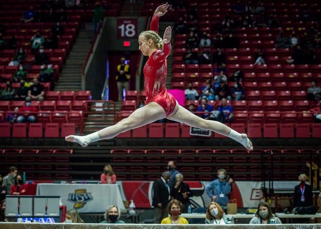 Richmond junior Liz Ruger performing her beam routine in the state gymnastics finals at Worthen Arena Saturday, March 13, 2021.