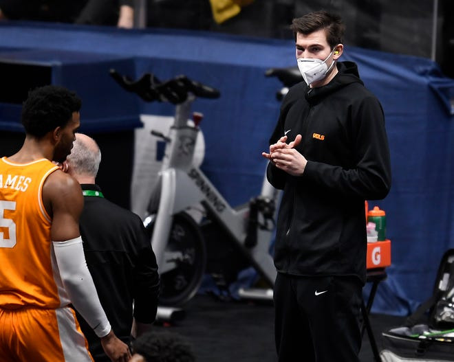 Tennessee forward John Fulkerson watches his teammates from the bench during the first half Saturday of the SEC Men's Basketball Tournament semifinal game against Alabama at Bridgestone Arena in Nashville, Tenn.