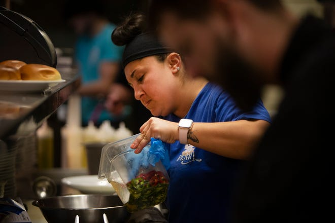 Gillian Kogan, executive chef at The Pearl Steak & Seafood Restaurant in North Naples, prepares a dish with her staff, Friday, March 12, 2021, at her restaurant in North Naples.