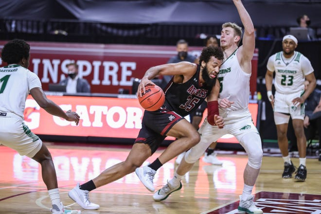 Johnny McCants (35) drives to the hoop as the New Mexico State Aggies face the Utah Valley Wolverines at The Orleans Arena in the Semifinals of the WAC Tournament in Las Vegas on Friday, March 12, 2021.