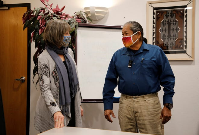 Jamie Church, Farmington Chamber of Commerce president and CEO, left, and Jeff Begay, board chairman of the Dineh Chamber of Commerce, talk on March 13 after signing the memorandum of understanding in Farmington.