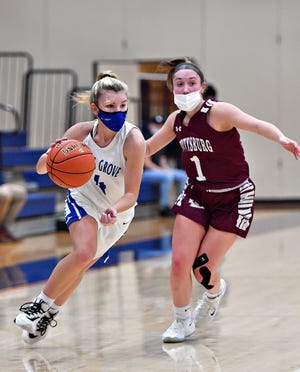 Spring Grove's Addyson Wagman, left, drives the ball down the court while Gettysburg's Camryn Felix defends during PIAA District 3, Class 5-A girls' basketball championship action at Spring Grove Area High School in Jackson Township, Friday, March 12, 2021. Spring Grove would win the title game 58-43. Dawn J. Sagert photo