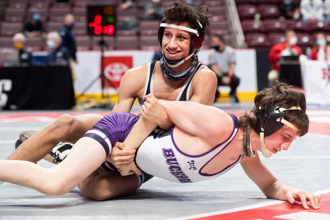 Chambersburg's Karl Shindledecker, top, wrestles Wallenpaupack's Gunnar Myers in a 120-pound quarterfinal bout at the PIAA Class 3A wrestling championship at the Giant Center in Hershey on Saturday, March 13, 2021. Shindledecker won by decision, 4-0.