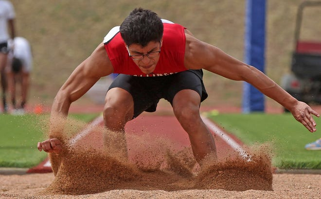 JoeMarcus Guerrero competes in the long jump for Ballinger in the San Angelo Relays on Thursday, March 11, 2021.