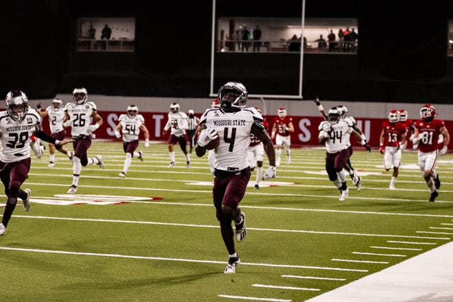 Missouri State's Montrae Braswell runs back a kickoff 100 yards for a touchdown against South Dakota on Sat., March 13 in Vermillion.