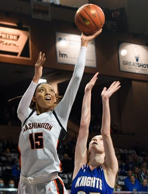 Washington's Ndjakalenga Mwenentanda makes a basket over O'Gorman's Bergen Reilly during the semifinals of the Class AA girls state tournament on Friday, March 12, 2021, at the Sanford Pentagon in Sioux Falls.