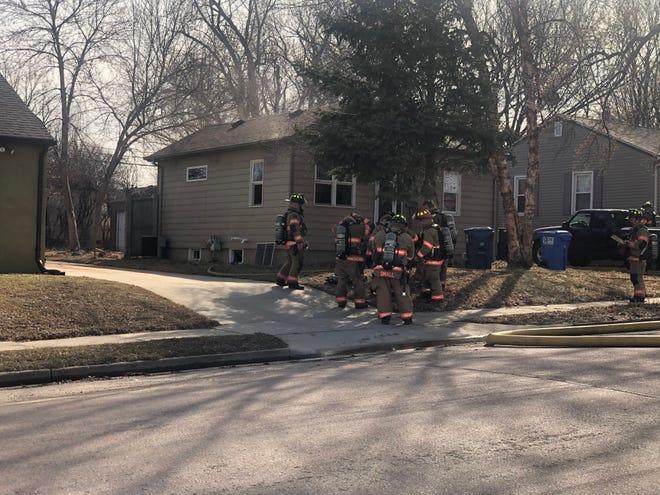 Sioux Falls Fire Rescue personnel outside a home on Jefferson Avenue.
