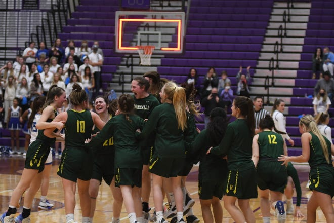 Aberdeen Roncalli celebrates after upsetting No. 1 St. Thomas More in the Class A semifinals on Friday, March 12.