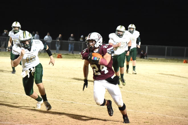 Aaron Nice looks for running room against Wilson Friday night, March 12. Stuarts Draft beat Wilson Memorial 42-7.