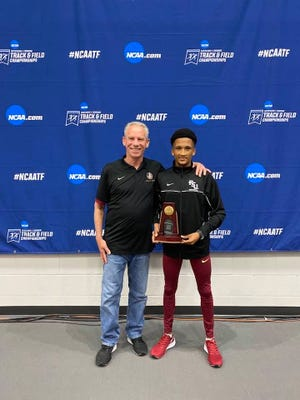 FSU's Adriaan Wildschutt and coach Bob Braman at the NCAA Indoor Track and Field Championships, where Wildschutt captured fourth place in the 5000 meters.