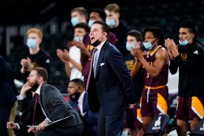 Iona coach Rick Pitino yells to his team in the first half of the game against Fairfield during the Metro Atlantic Athletic Conference final.