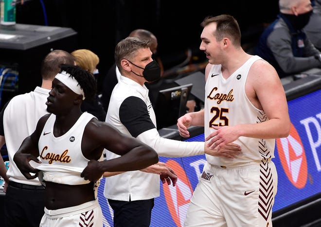 Loyola center Cameron Krutwig is congratulated by coach Porter Moser after he was taken out of the game during the second half against Indiana State in the semifinals of the Missouri Valley Conference tournament at Enterprise Center.