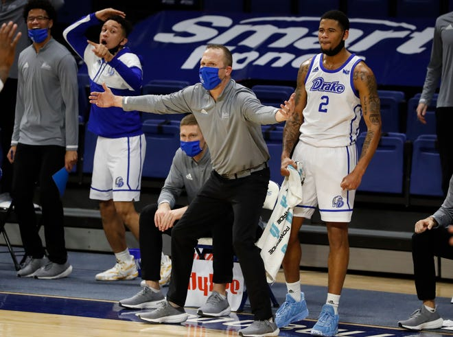 Drake coach Darian DeVries motions from the bench in the second half of play against the Northern Iowa Panthers at Knapp Center.