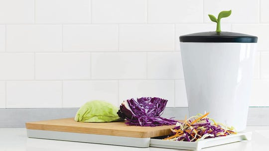 This compost bin will be an attractive addition to your kitchen.