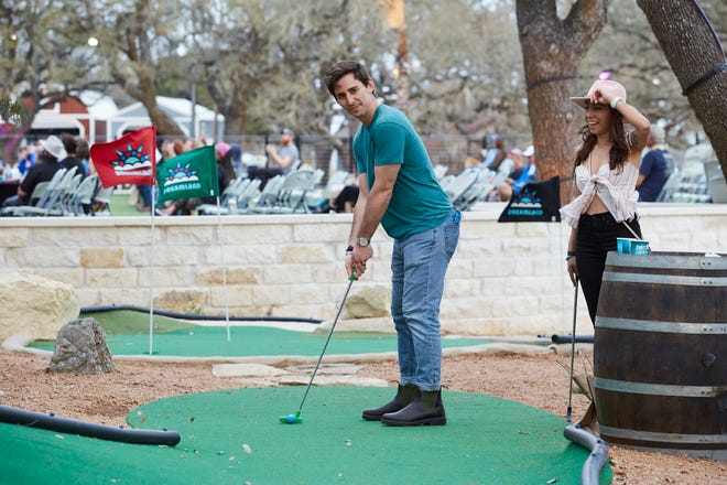 Danny Miller and Sophia DeLoretto-Chudy play mini-golf at Dreamland in Dripping Springs on March 13, 2021.