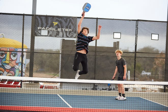 Nolan Dahl and Cooper Dixon play pickleball at Dreamland in Dripping Springs on March 13, 2021.