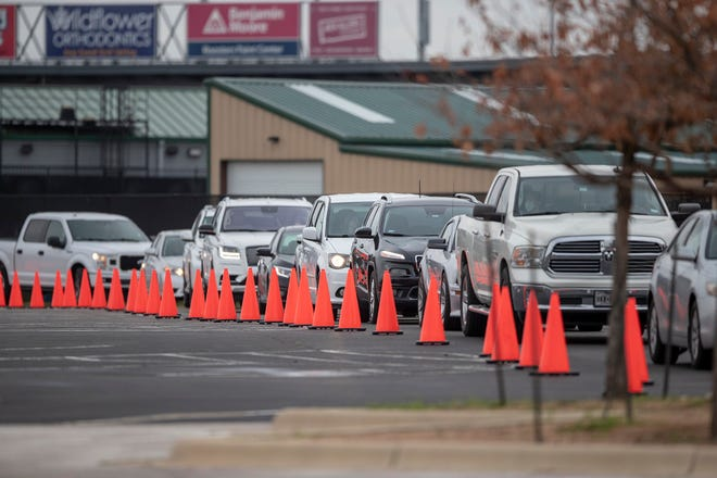 Hundreds of Williamson County residents wait in line for a COVID-19 vaccination at a mass vaccination site at the Dell Diamond on Sunday, March 14, 2021.