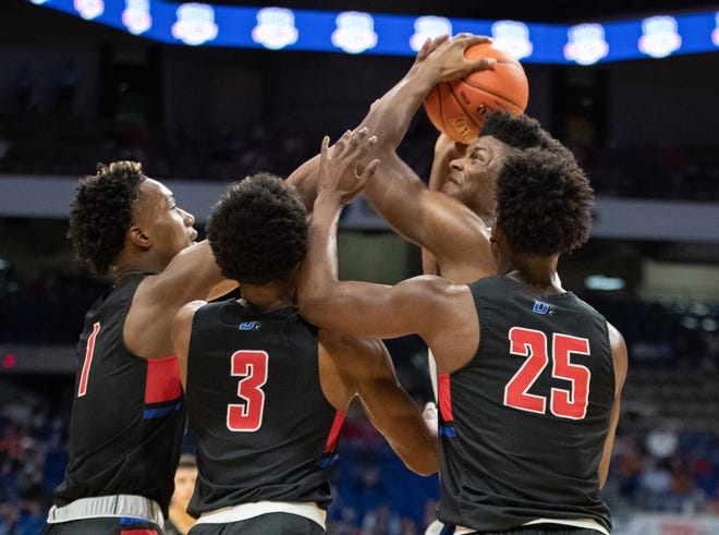 Westlake senior forward KJ Adams, swarmed by a host of Duncanville defenders, had 20 points and 12 rebounds in his final high school game. Next season he will play for Kansas