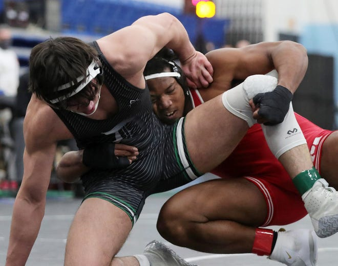 Canton McKinley's Mani Powell, right, takes down Dublin Coffman's Michael Blocher during their 220-pound match in the Division I State Wrestling Tournament at Hilliard Darby High School on Saturday. [Jeff Lange/Beacon Journal]