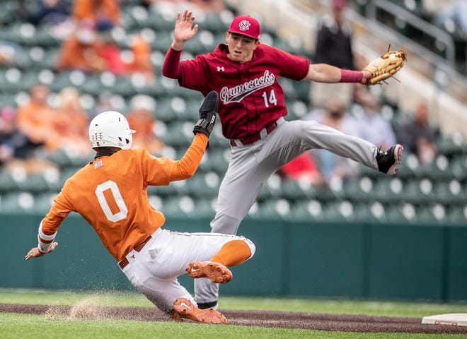 Texas infielder Trey Faltine slides in safe at second base against South Carolina's Joe Satterfield during the Longhorns' 8-5 win Sunday at UFCU Disch Falk Field. With the win, Texas swept the series from the Gamecocks.