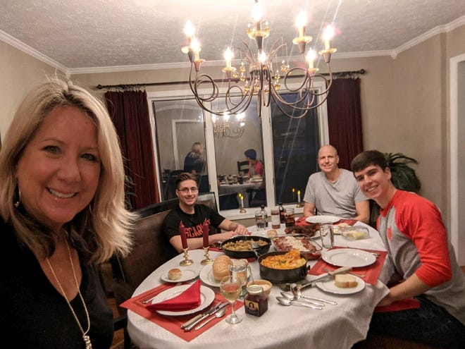 Gayle Martin at dinner with her husband, Michael and her two sons at dinner.