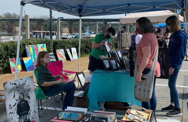 Residents shop for various hand-crafted items at the 5th Street Marina's first spring market on Sunday, March 14, near the Riverwalk in Augusta, Ga.
