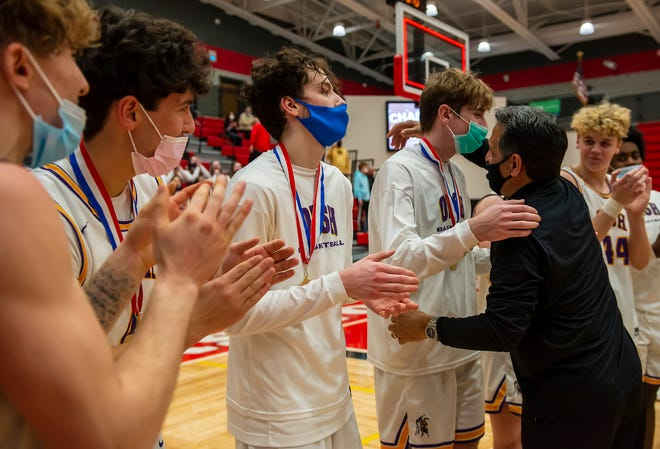 OLSH head coach Mike Rodriguez congratulates his players after giving them their WPIAL Class 2A championship medals. Rodriguez guided OLSH to a perfect season and the school's first state championship